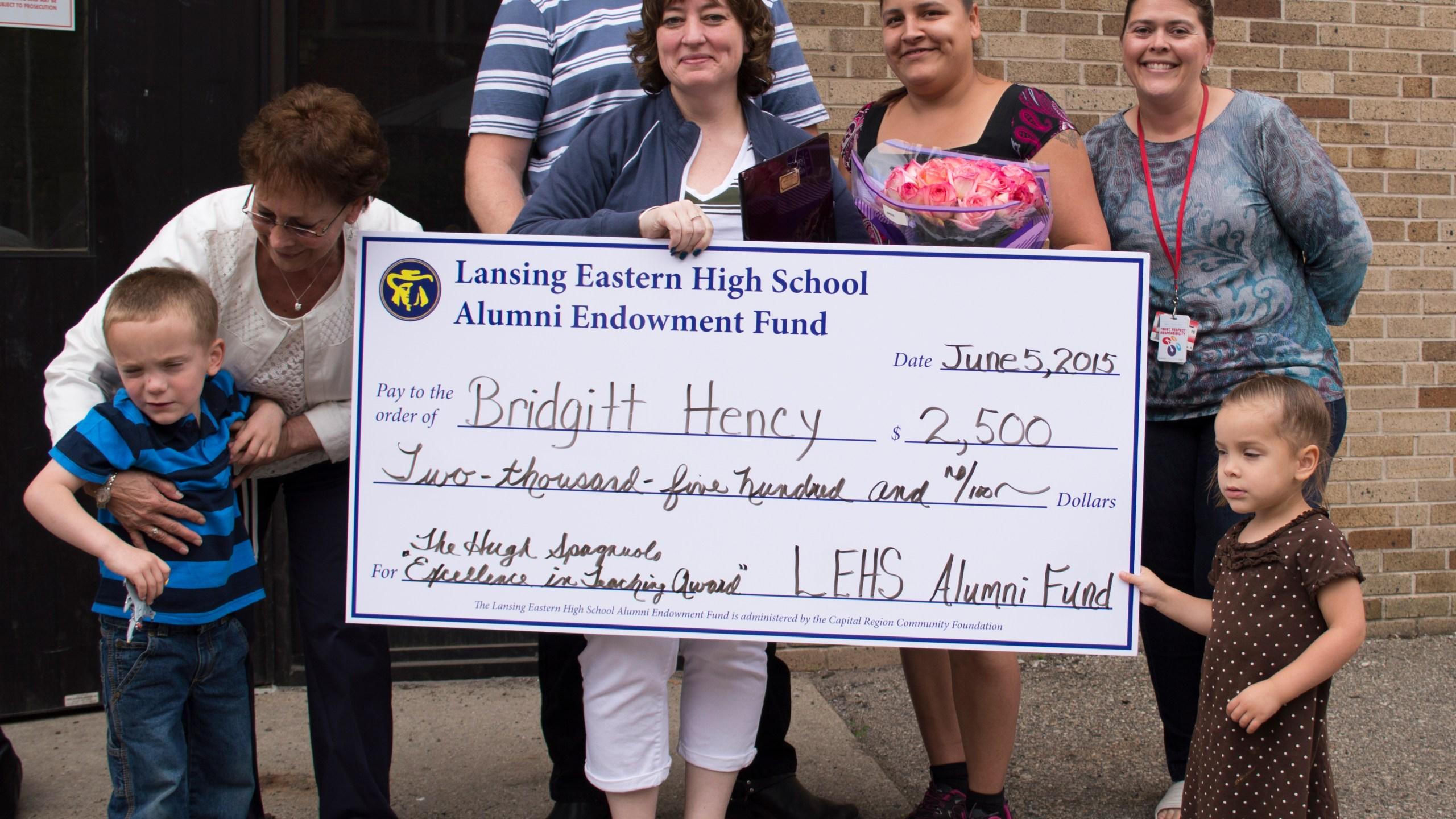 Bridgett Hency LEHS 2015 winner with family_56505