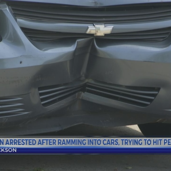 Man arrested after crashing into cars