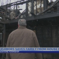 Family is saved by neighbor from house fire