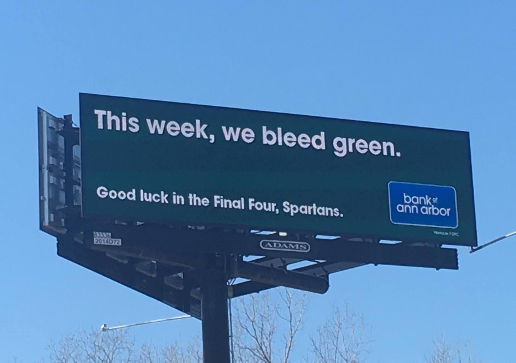 Bank of Ann Arbor This Week We Bleed Green Spartan support billboard_1554423382709.jpg.jpg