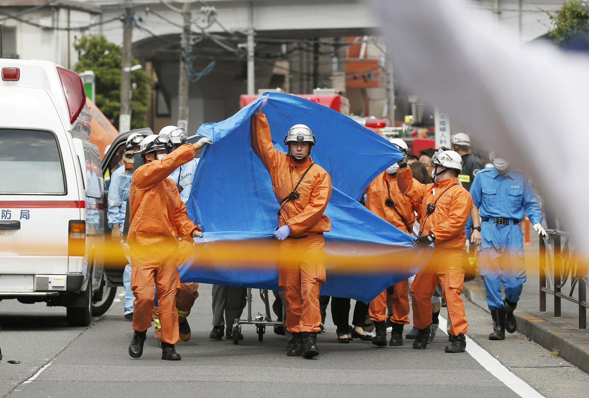 Rescuers work at the scene of an attack in Kawasaki near Tokyo_1559011439660.jpeg.jpg